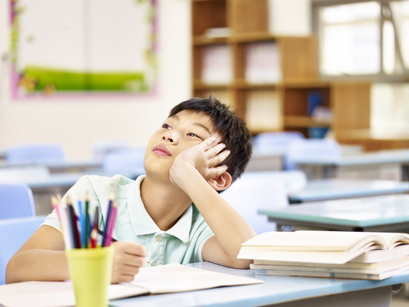 child who needs ADHD tutoring looking bored in class